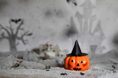 Orange scary pumpkin with witch hat. Halloween background. Closeup stock images