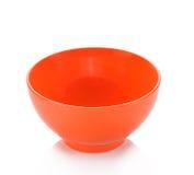 Orange Schüssel auf weißem Hintergrund Stockfoto