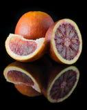 Orange Scheibe auf einem schwarzen Hintergrund Lizenzfreies Stockbild