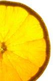 Orange Scheibe auf einer hellen Tabelle Lizenzfreie Stockfotografie