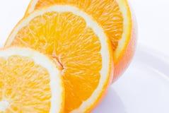Orange Scheiben auf Platte (1) Stockbild