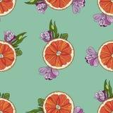 Orange Scheiben mit nahtlosem Muster der Blumen auf Knickentenhintergrund Stockfotos