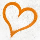 Orange Schmutzherz Stockbilder