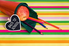 Orange school bag with text back to school Royalty Free Stock Photography