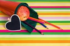 Orange school cone with blank heart Stock Image
