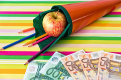 Orange school cone with money Royalty Free Stock Photos