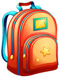 An orange schoolbag Stock Images