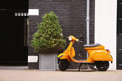 Orange scooter Royalty Free Stock Photography