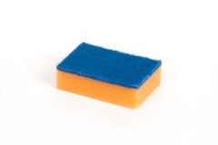 Orange scouring sponge Royalty Free Stock Images