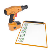 Orange screwdriver and a checklist Royalty Free Stock Photos