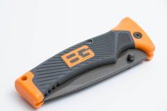 Orange se pliante d'édition de gerber de couteau de Grylls d'ours photographie stock