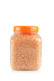 Orange sea salt in bottle isolated on a white Stock Photo