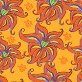 Orange seamless background with flowers. Stock Photos