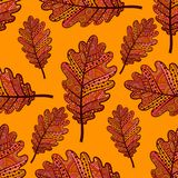 Orange seamless pattern with oak leaves. Stock Images
