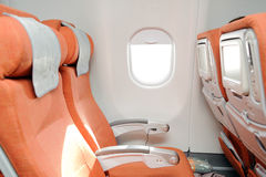Orange seats in airplane Royalty Free Stock Photo