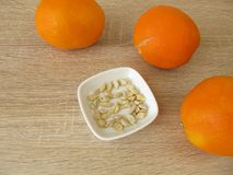 Orange seeds of sweet oranges for growing an orange tree. Seeds of sweet oranges for growing an orange tree stock image