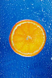 Orange segment on blue background Stock Photo