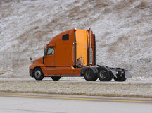Orange Semi Truck. On Highway without Trailer Stock Photos
