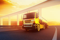 Orange semi truck with oil cistern on speed blured asphalt road. Highway at sunset - transportation background Royalty Free Stock Photography