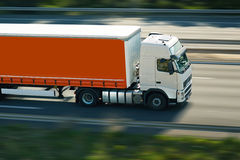 Orange semi truck Stock Photos