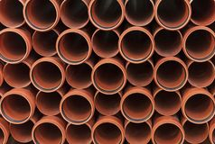 Orange sewer pipes. Background from plastic pipes stock photos