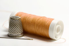 Orange sewing thread. Needle and thimble Stock Photography