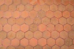 Orange sexhörningsgolvtextur Royaltyfria Bilder