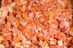 Orange shades of cubes from tropical dry fruit. Texture and background. Allsorts of tastes. Healthy food, vitamins, diet. royalty free stock photos