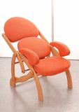 It is a orange shammy armchair. Stock Images