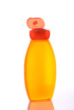 Orange shampoo bottle Stock Image