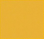 Orange shiny honeycomb full of honey cells decorative texture Royalty Free Stock Photography
