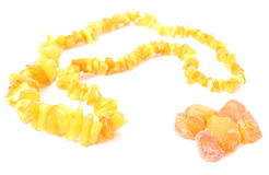 Orange, shiny necklace for the woman with raw amber Royalty Free Stock Photo