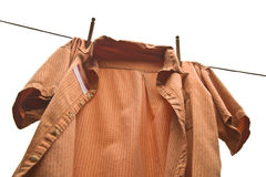 Orange shirt on a clothes line Royalty Free Stock Photos