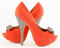 Shoes. And orange colored high heels and ornate stock photos