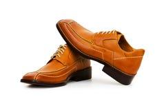 Orange shoes isolated Stock Images