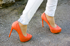 Orange shoes outdoors Stock Photo