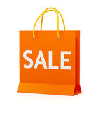 Orange shopping bag. Orange shopping paper bag with the word sale isolated on white Royalty Free Stock Images