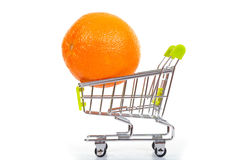 Orange in shopping cart Royalty Free Stock Photo