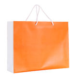 Orange shopping paper bag Stock Photos