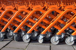 Orange shopping trolleys. Close up from orange shopping carts for a supermarket royalty free stock photo
