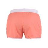Orange shorts on a white background Royalty Free Stock Photos