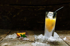 Orange Shot. Alcohol Orange Shot Drink with copyspace, on brown wooden board Royalty Free Stock Photos