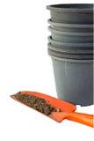 Orange shovel and flower pots Royalty Free Stock Photos