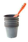 Orange shovel and flower pots Stock Photography