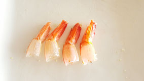 Orange shrimp tail of fried rice was eaten on white plate Stock Photo