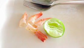 Orange shrimp tail of fried rice was eaten on white plate Royalty Free Stock Photos