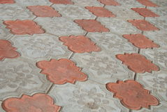 Orange sidewalk tile Stock Photography
