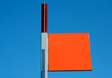 Orange sign. Square blank orange sign on a blue background Stock Photos