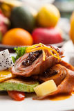 Orange signs star anise roast duck and potatoes with fresh fruit Stock Image