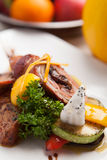 Orange signs star anise roast duck and potatoes with fresh fruit Royalty Free Stock Photo